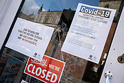 Local response to Coronavirus is felt on a street by street level as signs in small shops and businesses announce that they are closed for business until restrictions are lifted on 6th April 2020 in Birmingham, England, United Kingdom. Coronavirus or Covid-19 is a new respiratory illness that has not previously been seen in humans. While much or Europe has been placed into lockdown, the UK government has announced more stringent rules as part of their long term strategy, and in particular social distancing.