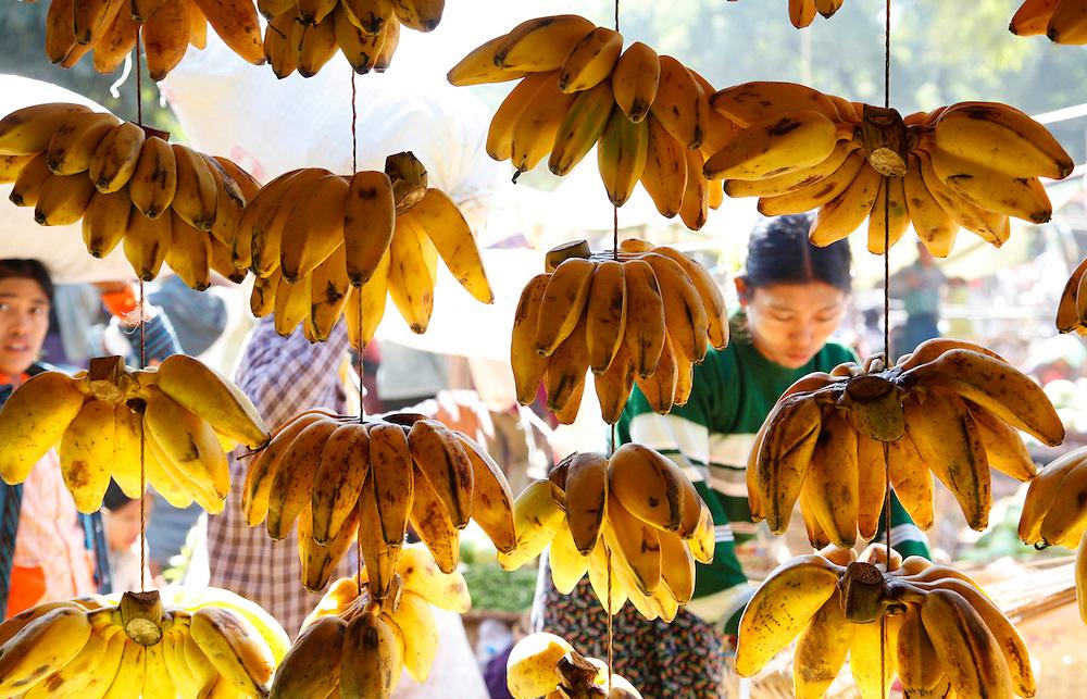 Marketplace vendor selling bananas. Mandalay, Myanmar