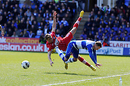 Reading's Chris Gunter collides with Southampton's Jay Rodriguez (9). Barclays Premier league, Reading v Southampton at the Madejski stadium in Reading on Saturday 6th April 2013. pic by Andrew Orchard, Andrew Orchard sports photography,
