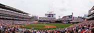 [Note:  This panorama was stitched from multiple photos during post-processing] A panoramic view of Minnesota Twins DH Jim Thome rounding the bases after hitting career homerun #596 against the Kansas City Royals on July 17, 2011 at Target Field in Minneapolis, Minnesota.  The homerun was estimated at 490 feet, which is the longest homerun ever hit at Target Field.