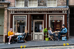 Edinburgh, Scotland, UK. 17 October 2020. Saturday afternoon in Edinburgh city centre during 16 day short circuit lockdown and bars are closed but cafes remain open. Streets in the Old town are very quiet and reminiscent of the eerie emptiness seen during the full lockdown earlier this year. Small bistro cafe open on West Bow. Iain Masterton/Alamy Live News