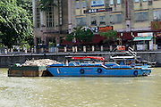 Singapore. Singapore River Cruise. A construction barge.