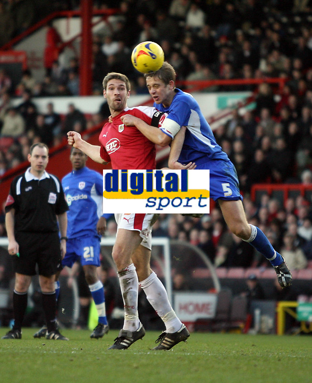 Photo: Rich Eaton.<br /> <br /> Bristol City v Millwall. Coca Cola League 1. 16/12/2006. Paul Robinson right of Millwall and Jamie McCome of Bristol both jump for the ball