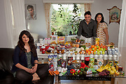Lorenskog, Oslo, Norway. Family portrait of the Qureshi family with one week's worth of food in June. The Hungry Planet project.