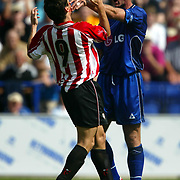 Leicester City's Matt Elliott pushes Athletic Bilboa's no. 9 after being elbowed by the Spaniard which resulted in him being sent off