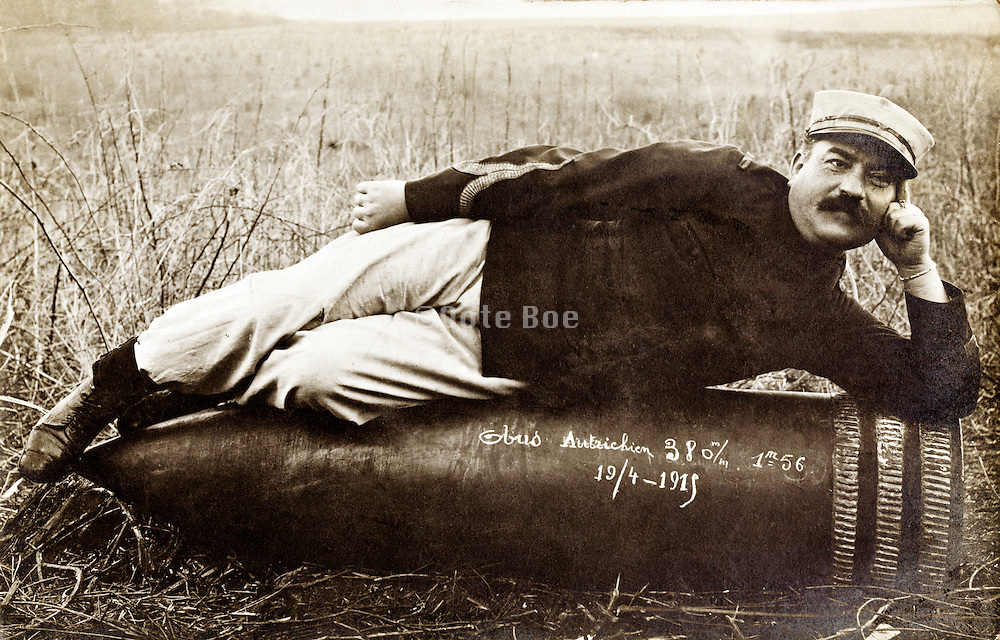 soldier laying on a very large cannon bullet of 380 mm with a length of  1.56 meter France 1919