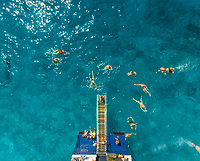 ITHAKI - GREECE, AUGUST 9 2018: Aerial view of people on ferry and swimming in sea, Ithaki island, Greece.
