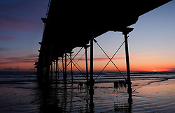© Licensed to London News Pictures. 28/04/2016. SALTBURN BY THE SEA, UK.  <br /> the horizon glows orange as the sun begins to rise over the beach and pier at Saltburn by the Sea.  <br /> Photo credit: Ian Forsyth/LNP