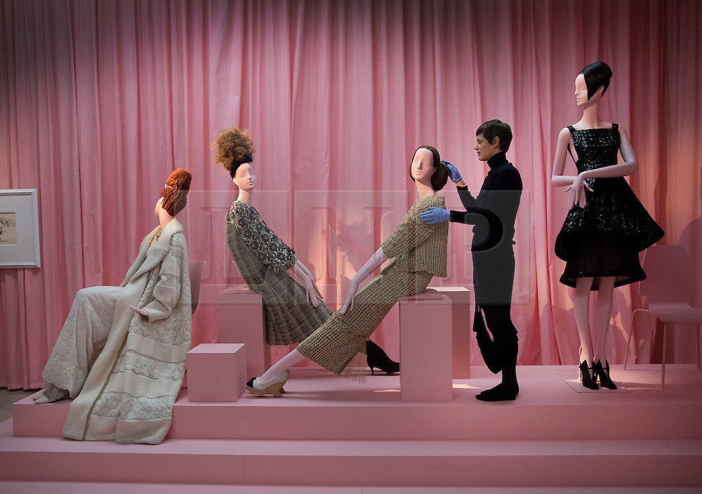 © Licensed to London News Pictures. 01/11/2016. London, UK. Curator Shonagh Marshall puts the finishing touches to a display of mannequins dressed in Chanel at the 'Hair by Sam McKnight' exhibition at Somerset House. The show, which runs from 2nd November, 2016 to 12th March, 2017, celebrates the career of fashion's favourite hair stylist. Photo credit: Peter Macdiarmid/LNP