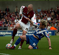 Photo: Ian Hebden.<br />Northampton Town v Chester City. Coca Cola League 2. 29/04/2006.<br />Northamptons Josh Low (L) is tackled by  Chesters Ben Davies (R).