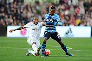 Clinton N'Jie of Tottenham Hotspur is tackled by Ashley Williams of Swansea city.  Barclays premier league match, Swansea city v Tottenham Hotspur at the Liberty Stadium in Swansea, South Wales on Sunday 4th October 2015.<br /> pic by  Andrew Orchard, Andrew Orchard sports photography.