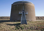 Metal staircase leading up to doorway of martello tower converted into a home, Alderton, Suffolk, England