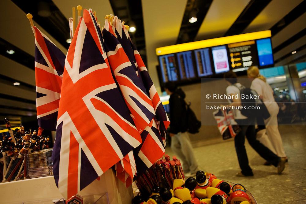 'Glorious Britain' Union Jack flags in retail shop at Heathrow's Terminal 5.
