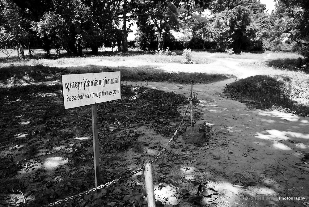 A sign at the site of a mass grave at Choeung Ek, 17 km South of Phnom Penh, Cambodia