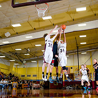 012613      Brian Leddy<br /> Rehoboth Lynx Jesse Johnston (32), Chad Castillo (34) and Crownpoint Eagle Nicolas Chischilly (5) reach for a rebound during Monday night's game at Rehoboth.