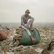 Hamid, a cloth recycler in Bhalswa, on top of one of the giant open air garbage dump which burns 24/7, creating toxic fumes.