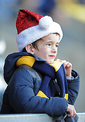 A young festive Oxford United supporter at the Kassam Stadium - Photo mandatory by-line: Paul Knight/JMP - Mobile: 07966 386802 - 06/12/2014 - SPORT - Football - Oxford - Kassam Stadium - Oxford United v Tranmere Rovers - FA Cup Second Round