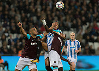 Football - 2017 / 2018 Premier League - West Ham United Vs Huddersfield Town<br /> <br /> Tom Ince (Huddersfield Town) gets squeezed out by Winston Reid (West Ham United) and Pedro Obiang (West Ham United) at the London Stadium<br /> <br /> COLORSPORT/DANIEL BEARHAM