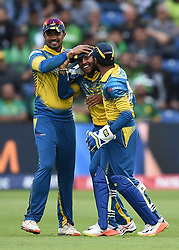 Sri Lanka's Kusal Mendis (centre) celebrates taking a catch to dismiss Pakistan's Azhar Ali during the ICC Champions Trophy, Group B match at Cardiff Wales Stadium.