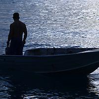 Fare, Huahine, French Polynesia, fisherman in boat