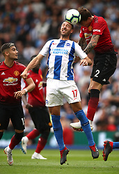 Brighton & Hove Albion's Glenn Murray (centre) and Manchester United's Victor Lindelof (right) battle for the ball