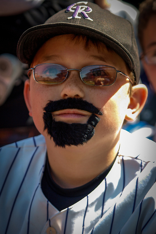 10 year-old NICK BESSMAN, dressed as Colorado Rockies first baseman Todd Helton, awaits the start of the Rockies home-opening game.  The Rockies lost 1-8 to the Arizona Diamondbacks in MLB action.