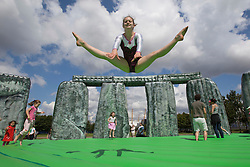© licensed to London News Pictures. London, UK 21/07/2012. Artemis Saddington from Camden Gymnastics Squad posing on Jeremy Deller's life-size bouncy castle version of Stonehedge, entitled Sacrilege which comes to London as a part of the London 2012 Festival on 21/07/12. Photo credit: Tolga Akmen/LNP