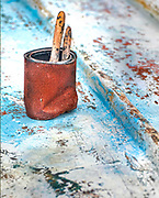 Old Boatyard with bottom paint and rusted can.