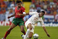Fotball<br /> Euro 2004<br /> Portugal<br /> 30. juni 2004<br /> Foto: Pro Shots/Digitalsport<br /> NORWAY ONLY<br /> Semifinale<br /> Portugal v Nederland 2-1<br /> Michael Reiziger og Luis Figo