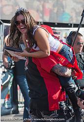 Custom bike show winner carries off Miss Arizona Bike week at Arizona Bike Week's Cycle Fest at Westworld. USA. April 5, 2014.  Photography ©2014 Michael Lichter.