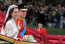 Embargoed to 0001 Monday April 23 File photo dated 29/04/11 of Prince William and his wife Kate, Duchess of Cambridge, traveling in the 1902 State Landau carriage after their wedding service at Westminster Abbey, as figures have revealed for the first time that the security operation for their wedding cost police more than £6 million.