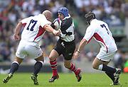 Twickenham. England. RFU Stadium, Surrey. <br /> Photo Peter Spurrier25/05/2003<br /> 2003 - Rugby - England v Barbarians.<br /> David Humphreys look's to go through the gap between David Flatman [left] and Michael Lipman         [Mandatory Credit: Peter SPURRIER/Intersport Images]