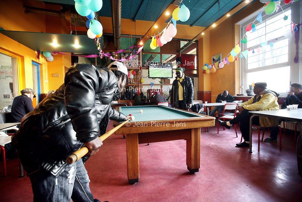 Nederland,Amsterdam, 2 december 2013.<br /> Inloophuis Blaka Watra op Droogbak 1c voor  daklozenopvang en verslavingszorg.<br /> Homeless and addicts shelter in the center op Amsterdam.