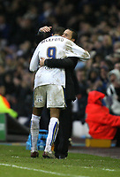 Photo: Paul Greenwood/Sportsbeat Images.<br />Leeds United v Huddersfield Town. Coca Cola League 1. 08/12/2007.<br />Leeds manager Dennis Wise (R) hugs Jermaine Beckford as he leaves the field