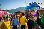 A teenage boy selling helium balloons outside a fairground on the 6th of March 2020 in Paudi, Sundarbazar, Lamjung District, Gandaki Pradesh, Nepal.  The fairground is part of the Holi celebrations, also known as Festival of Colours, is one of the most popular festivals in Nepal. It takes place on the full moon day in Nepali Fagu month (February to March in Solar Calendar) and lasts for 2 days. (photo by Andrew Aitchison / In pictures via Getty Images)