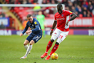 Southend United midfielder Michael Kightly (7) and Charlton Athletic defender Mouhamadou-Naby Sarr (23) during the EFL Sky Bet League 1 match between Charlton Athletic and Southend United at The Valley, London, England on 9 February 2019.