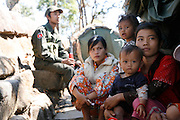 Young mothers, babies and children, soldiers' families, literally on the frontline, a few hundred metres from the Thai border nearby Prasat Preah Vihear temple situated in the Dângrêk Mountains..Touth Koeun, an ex-Khmer Rouge child soldier turned midwife and trainer, is on the frontline again, but this time campaigning on maternity issues, in Preah Vihear province, Cambodia. The country experiences an extraordinarily high incidence of infant and maternal mortality. The Preah Vihear province, in Cambodia's north, bordering on the Thai border, can be described as an outback rural area, villages often many hours away from a health centre or clinic, and sometimes near the frontline where soldiers and their families are living. Here, Touth Kouen, a locally much respected pioneer and experienced in maternity issues, trains indigenous women, known as 'Traditional Birth Attendants' (TBA's), correct procedures to assist midwives and nurses, to give direct support to mothers and their babies, during ante and post natal periods. Traditional bush medicine and spiritual practices by 'Kruu' bush doctors, involving the killing of endangered species, gathering herbs and plants, whose burnt remains are often ground up into unhealthy potions, and fed to mothers as miracle cures, and postpartum heating, can cause illness and death. The Kruu, and local people in general need to be re-educated, so as to create a healthy nurturing environment for mothers and their babies. Preah Vihear Province, Cambodia