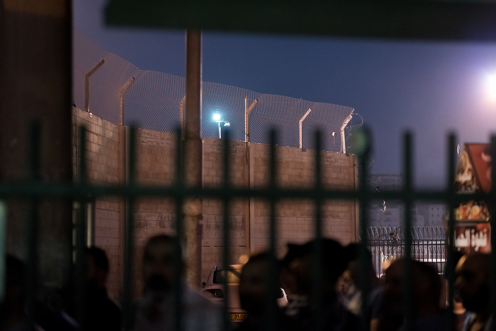 8 October 2018, Jerusalem, Occupied Palestinian Territories: Qalandiya is the main checkpoint between the northern West Bank and Jerusalem, where thousands upon thousands of Palestinians try to make their way to Jerusalem each day. Ecumenical accompaniers (EAs) from the World Council of Churches' Ecumenical Accompaniment Programme in Palestine and Israel (WCC-EAPPI) visit regularly in the early mornings. Their task is to be an international presence and to show solidarity, offer basic support to anyone denied passage, and collect documentation of the situation at the checkpoint. EAs' reports feed into the UN system, providing ongoing monitoring of the human rights situation in Israel and Palestine.