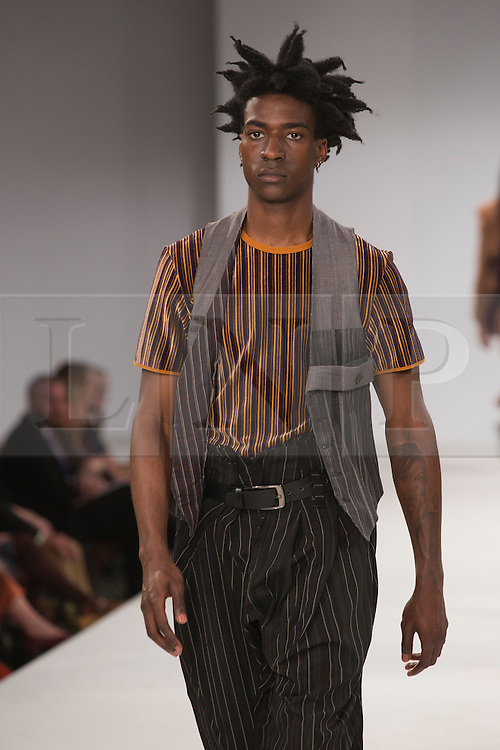 © Licensed to London News Pictures. 30/05/2015. London, UK. A model walks the runway during the UCA Rochester fashion show at Graduate Fashion Week 2015 wearing the collection of graduate student Jo Igao. Graduate Fashion Week takes place from 30 May to 2 June 2015 at the Old Truman Brewery, Brick Lane. Photo credit : Bettina Strenske/LNP