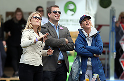 Peter and Autumn Phillips (left) watch daughters Savannah and Isla on a climbing wall during the Royal Windsor Horse Show, which is held in the grounds of Windsor Castle in Berkshire.