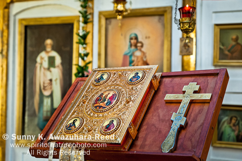Close up of historical bible and cross at Holy Transfiguration of Our Lord Chapel, Ninilchik, Kenai Peninsula, Southcentral Alaska.