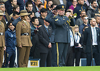 Football - 2016 / 2017 Premier League - Tottenham Hotspur vs. Leicester City<br /> <br /> A lone bugler plays the last post in memory of fallen comrades at White Hart Lane.<br /> <br /> COLORSPORT/DANIEL BEARHAM