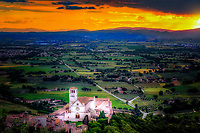 """""""The last rays of the sun fall on the Papal Basilica of St. Francis""""…<br /> <br /> This image is a horizontal view of the many mystical and blessed of my perfect 24 hours in Assisi. Upon arrival early that day I began taking photos the second I parked at Hotel Giotto just inside the walls in the foothills of Assisi. Perhaps Saint Francis arranged the dramatically perfect skies and coordinated every encounter. Beginning at the Basilica of Saint Francis, every second of the climb to the top of the mountain to the fortress Rocca Maggiore, a new surprise awaited around every corner. Upon my final steps to the top at almost sunset, the clouds parted and the low sun brightened as a slight mist of rain came down. Looking back over my shoulder, the appearance of a rainbow shone down between the Duomo of Saint Rufino, and the Basilica of Saint Clare. After the first small rainbow dissipated...I moved about 200 yards to the opposite view facing the setting sun over the Basilica of St. Francis. I was fortunate to capture several dramatic images just before another rainbow appeared behind me...a spectacular and blessed show by the hand of God."""