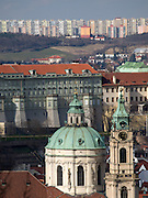 Im Vordergrund Turm und Kuppel der St. Niklas Kirche am Kleinseitner Ring (Malostranske Namesti) - im Hintergrund Plattenbauten.<br /> <br /> Prague urban landscape - in front parts of the St. Nicholas church at Malostranska square (Malostranske Namesti) - in the back panel houses.