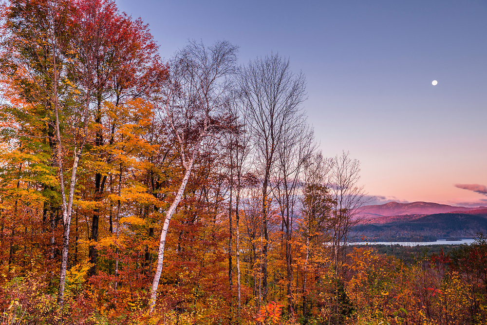 Pink first light on fall foliage and mountains, with Newfound Lake views, Bridgewater, NH