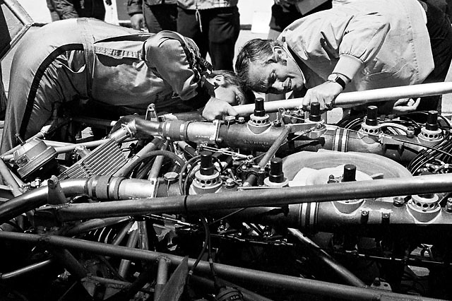 Mark Donohue (left) and Roger Penske examine turbocharged engine of Porsche 917/10K Can-Am car at Mosport, Canada, in the car's 1972 debut race.