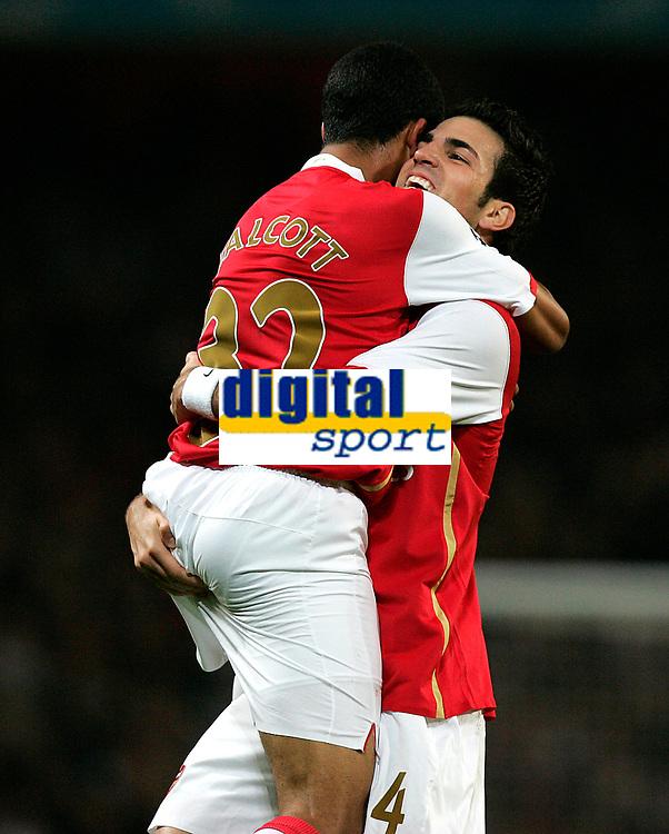 Photo: Tom Dulat.<br /> Arsenal v Slavia Prague. Group H, UEFA Champions League. 23/10/2007.<br /> Theo Walcott (L) celebrates his goal together with Cesc Fabregas(R). Arsenal leads 3-0