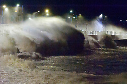 © Licensed to London News Pictures. 09/02/2020. Porthcawl, Bridgend, Wales, UK.  Massive waves poound the promenade in the Welsh seaside resort of Porthcawl in Bridgend, UK. Photo credit: Graham M. Lawrence/LNP