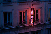 "Neon sign outside the Amour Hotel at 8 rue Navarin, 9th Arrondissement, Paris, France. Seen from another hotel on the same street, we see the glow of the letters showing the name of this trendy address in central Paris, the French capital. The Amour is one of the first designer budget hotels is still going strong in the South Pigalle (aka ""SoPi"") district, with its unique artist-decorated rooms that focus more on style than useless amenities."