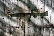 Barred wooden barn door. Conner Prairie Interactive History Park provides family-friendly fun for all ages in Fishers, Indiana, USA. Founded by pharmaceutical executive Eli Lilly in the 1930s, Conner Prairie living history museum now recreates life in Indiana in the 1800s on the White River and preserves the William Conner home (listed on the National Register of Historic Places).